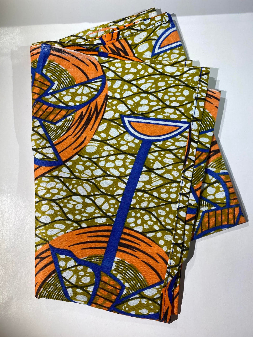 African Head Wrap: Brown, Orange, and Blue.