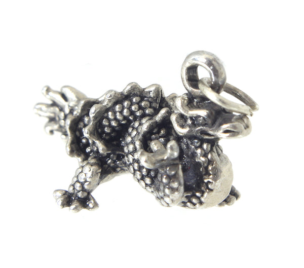 Dragon charm/pendant, twisting tail, Sterling Silver