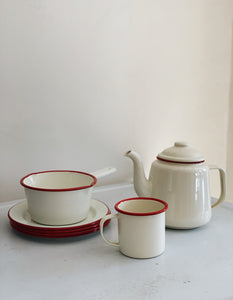 Falcon enamelware camping set, teapot, milk pan, mug and plates, in cream and red rim.