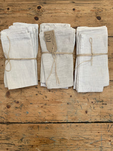 A pile of grey linen napkins. sets of 2, 4 and 6