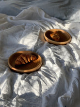 Load image into Gallery viewer, Two handmade wooden plates with croissants placed on a white linen duvet for breakfast in bed, sunlight shining across the bed. Autumn light