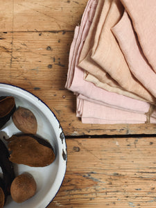 Hand dyed linen napkins in blush pink and coral by Tanya Robinson at Felt College. Using European Oeko-Tex 100 white linen fabric in an avocado dye bath. Sustainable, made in UK, relaxed dining. Sets available