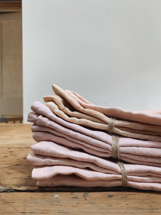 Hand dyed linen napkins in blush pink and coral by Tanya Robinson at Felt College. Using  European Oeko-Tex 100 white linen fabric. Sustainable, made in UK, relaxed dining.  Sets available