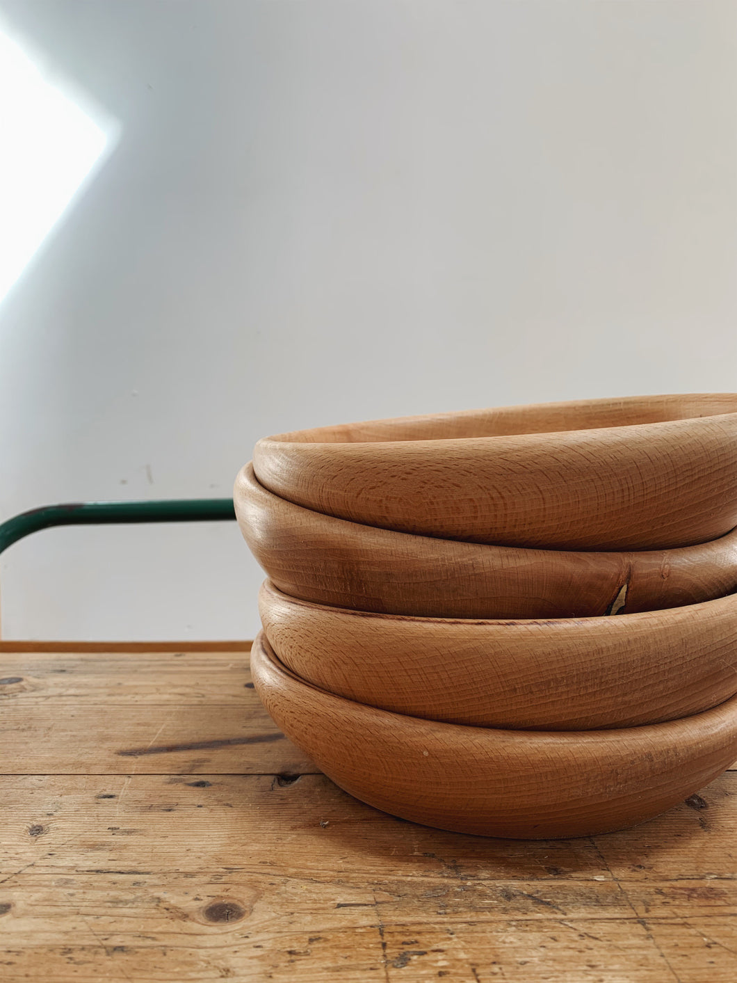 Stack of hand turned wooden bowls and plates,  made using sustainable beech timber. Plastic free picnics,. Eco friendly tablescapes. Natural table setting for gatherings.  Available to buy