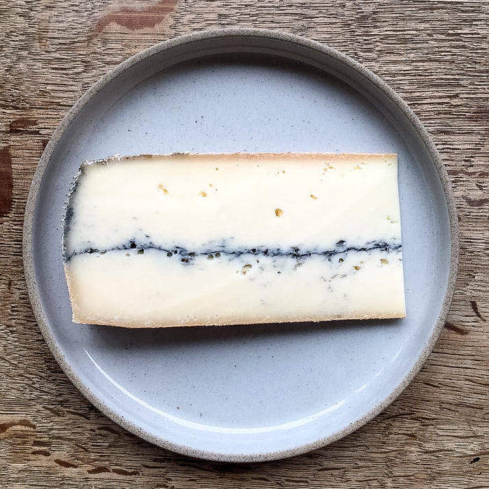 Cow's milk cheese from the Jura with a line of ash in its middle. One to melt in toasties or have as it is.