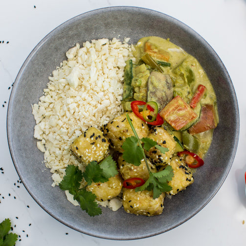 Tofu & Pumpkin Green Curry, Cauliflower Rice, in a grey bowl, shot from above