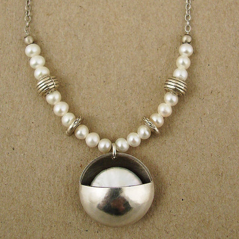 Sterling and pearl cupped moon pendant by Ian Gibson