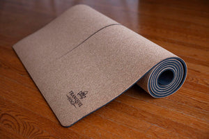 Partially Rolled Tranquility Premium Cork Yoga Mat