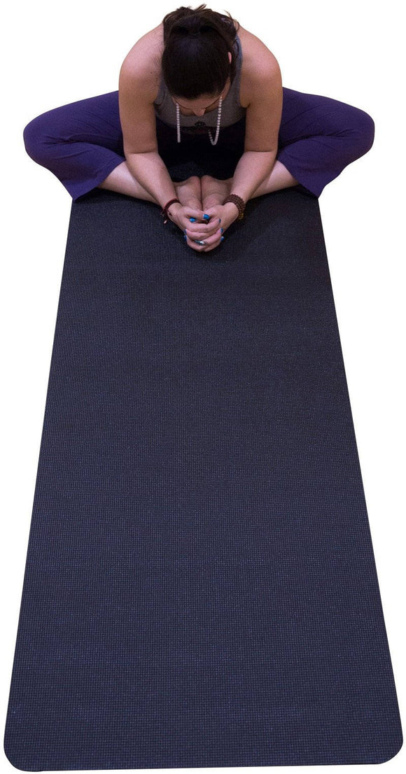 Person stretching on Yoga Mat