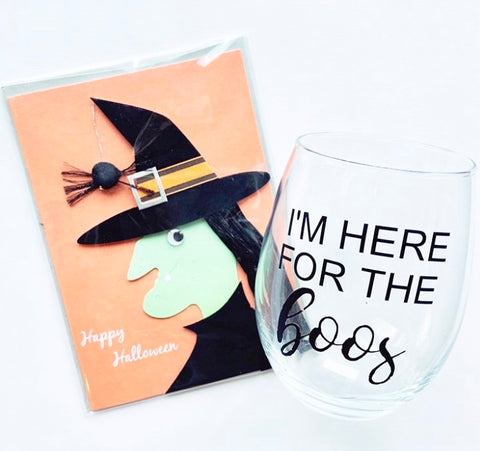 "alt=""Clear stemless wine glass with 'I'm here for the boos' sentiment"""