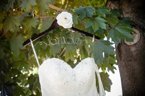 "alt=""Custom wood and wire bridal hanger with ivory flower detail"""