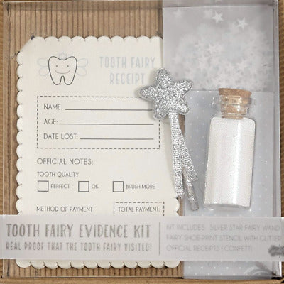 "alt=""Gender neutral Tooth Fairy Evidence Kit complete with silver star fairy wand, fairy shoe-print stencil with glitter, official receipts and confetti and comes packaged in a corrugated gift box"""