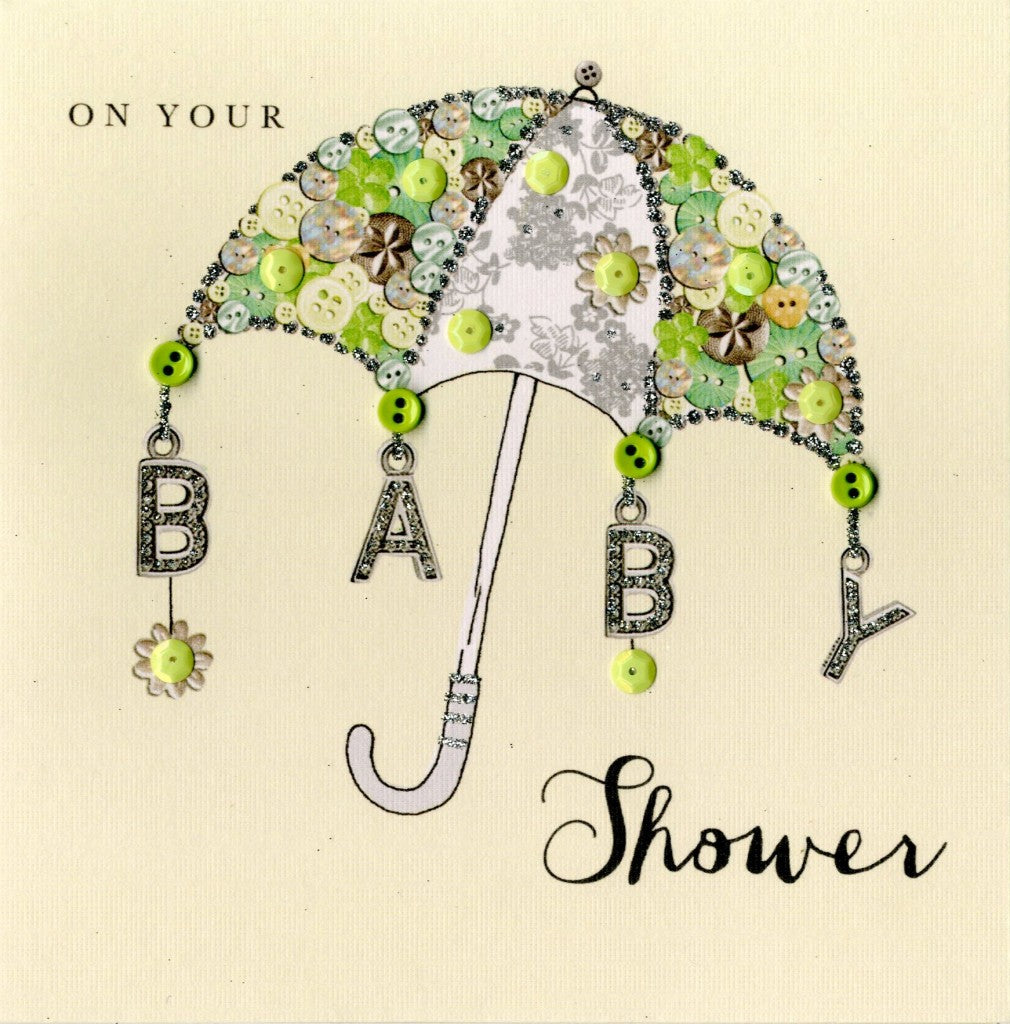 "alt=""Baby Shower Umbrella quality hand-finished, green button, sequin and glitter embellished greeting card sealed in a protective wrapping complete with envelope. Message: On your Baby Shower. May life shower you and your baby with happiness and wonderful moments to treasure"""