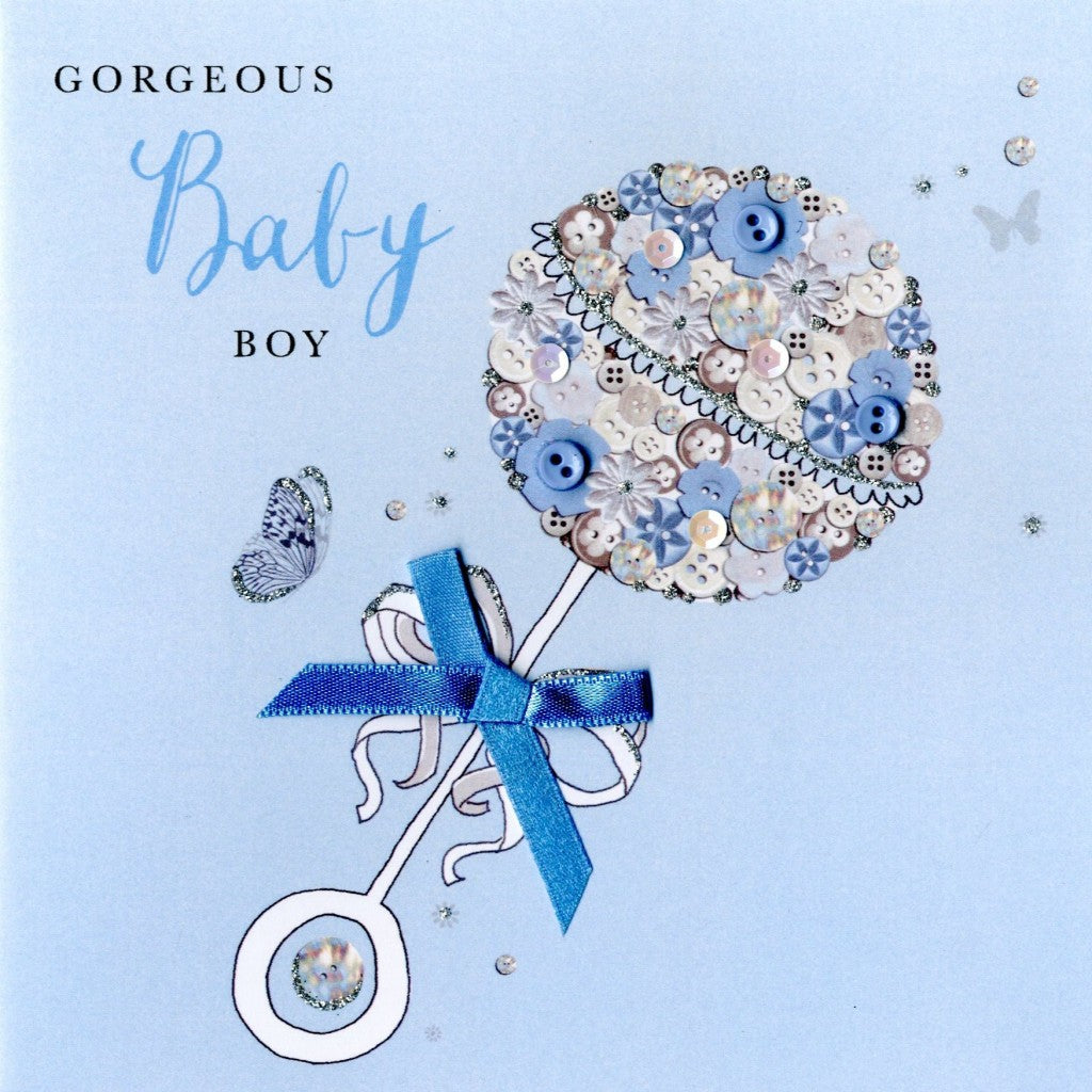 "alt=""Baby Boy Rattle quality hand-finished, blue button, sequin and glitter embellished greeting card sealed in a protective wrapping complete with envelope. Message: Gorgeous Baby Boy. Wishing you a world of happiness with your new arrival"""