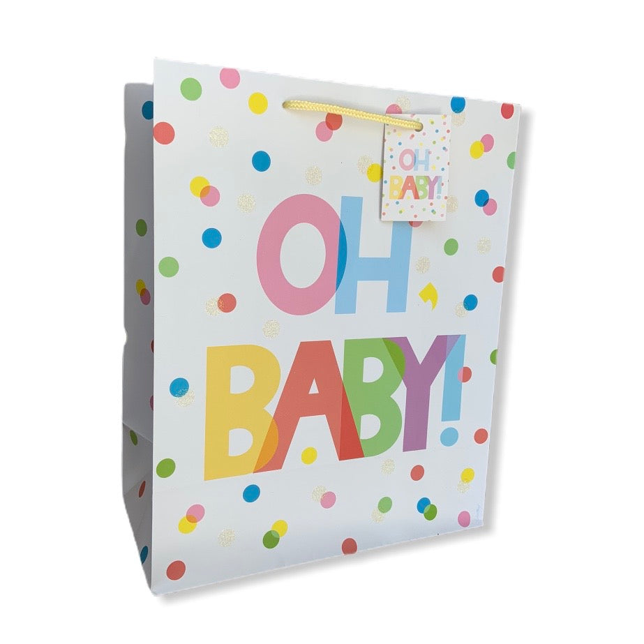 Oh, Baby! gift bag with glitter accents and an adorable polka dot pattern is the perfect packaging solution for any new arrival.