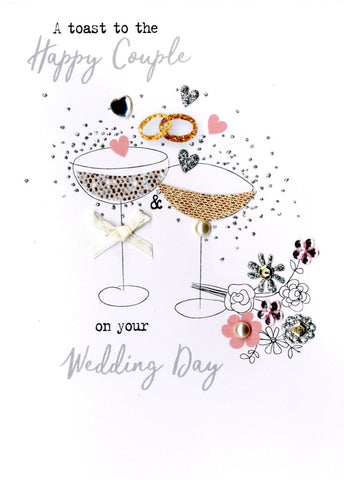Quality hand-finished, glitter embellished greeting card by Second Nature sealed in a protective wrapping complete with envelope.  Message: A toast to the Happy Couple on your Wedding Day. Wishing you love , laughter and happily ever after!