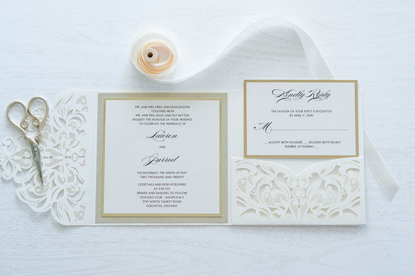 "alt=""Elegant ivory pearlescent shimmer laser cut square pocket fold wedding invitation features an ivory pearlescent shimmer stock on gold mirror and glitter stock layers and a jewel detail"""