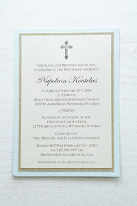 "alt=""Classic layered Baptism invitation features an ivory pearlescent shimmer card stock on a gold glitter and soft blue pearlescent shimmer card stock and an elegant cross and jewel detail"""