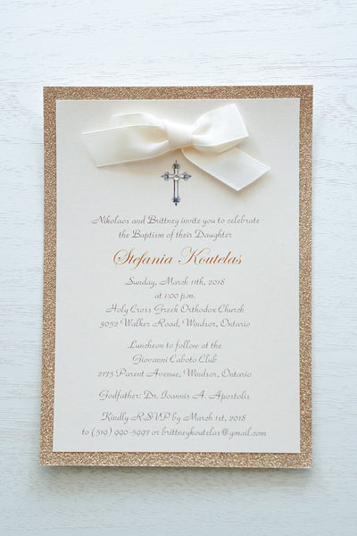 "alt=""Classic embellished Baptism invitation features a soft pink pearlescent shimmer card stock on a rose gold glitter card stock, an elegant cross and jewel detail finished with a rich ivory satin ribbon bow"""