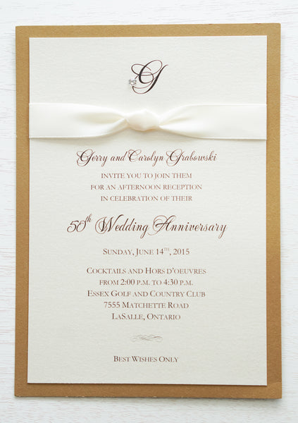 "alt=""Classic 50th Wedding Anniversary invitation features an ivory pearlescent shimmer card stock on a gold leaf pearlescent shimmer card stock, an elegant monogram and jewel detail and is finished with a rich ivory knotted ribbon"""