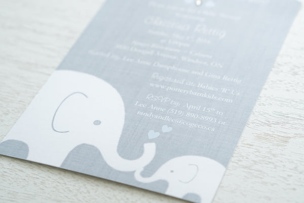 "alt=""Sweet baby shower invitation features a grey background print and a white baby and mama elephant image with blue hearts. Heart colour can be customized to suit gender"""