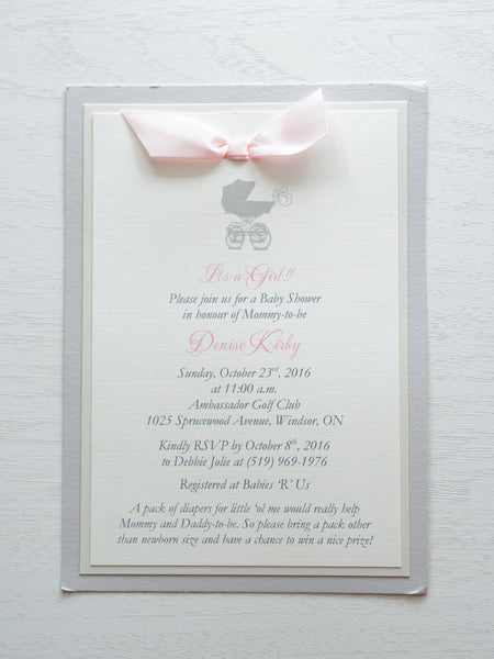 "alt=""Classic invitation features ivory linen matte card stock on ivory pearlescent shimmer and grey pearlescent shimmer card stock with a grey pram and a rich pink satin ribbon bow detail"""