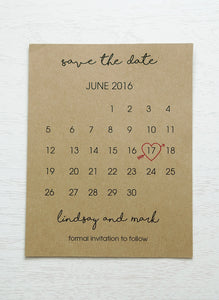 "alt=""Rustic calendar save the date card is printed on a kraft card stock and features your wedding month/day highlighted with a red heart"""