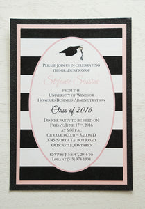 "alt=""Modern graduation party invitation features a matte white card stock on a pink pearlescent shimmer stock layered on a black glitter stock, a black grad cap and jewel detail and an oval design with a black and white striped pattern to finish it off"""
