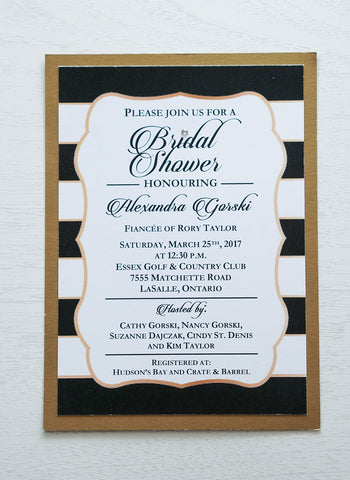 "alt=""Modern Bridal Shower invitation features a matte white stock on an antique gold pearlescent shimmer stock, a black and white striped background with a gold frame, a bold script font and a jewel detail to finish it off"""