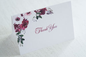 "alt=""Elegant thank you card features a white pearlescent shimmer card stock and a beautiful purple watercolour floral design in the top left corner"""
