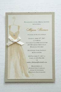 "alt=""Elegant Bridal Shower invitation features an ivory pearlescent shimmer card stock on a gold leaf pearlescent shimmer stock, a beautiful gold watercolour wedding dress design complete with jewel detail and a rich satin ivory ribbon bow to finish it off"""