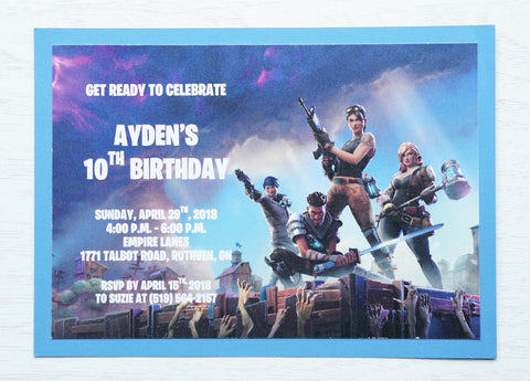 "alt=""Adventure video game invitation features a matte white and blue card stock and a Fortnite themed design"""