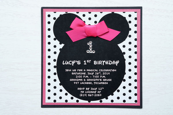 "alt=""Fun Disney inspired birthday party invitation features a matte white stock on hot pink pearlescent shimmer and matte black card stock layers, Minnie Mouse ears, an elegant jewel age detail, a black polka dot background and is finished off with a rich pink ribbon bow to match"""