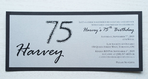 "alt=""Modern and fun tea length birthday invitation features a silver pearlescent shimmer card stock on a matte black stock, the honouree's name in script and their age highlighted with silver glitter sparkle"""