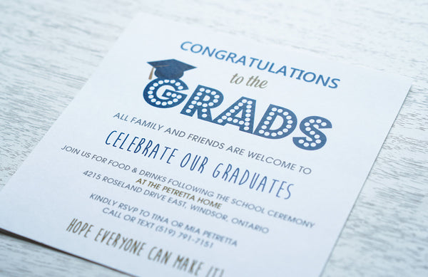 "alt=""Blue and gold graduation party invitation is printed on white matte card stock and features fun fonts and a blue grad cap and marquee lettering design"""
