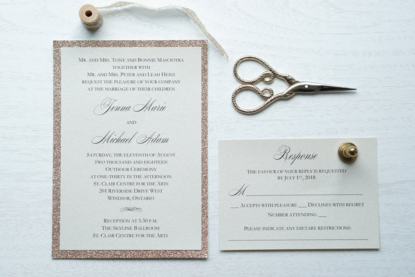 "alt=""Classic wedding invitation features an ivory pearlescent shimmer card stock layered onto rose gold glitter and an elegant script font"""