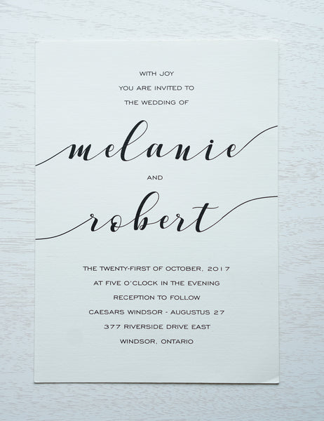 "alt=""Simple wedding invitation features an ivory linen matte card stock and a fun calligraphy font in black"""