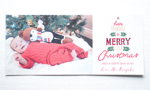 "alt=""This festive photo card features a white pearlescent card stock, ""Have yourself a Mery Little Chirstmas and a Happy New Year"" printed tree pattern with buffalo plaid and jewel detail as well as a photo of your choice"""