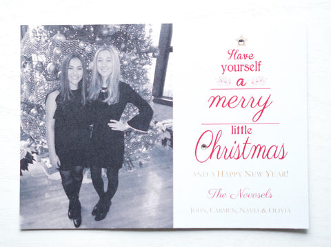 "alt=""This festive photo card features a white pearlescent card stock, ""Have yourself a Merry Little Christmas and a Happy New Year"" printed in a red tree pattern with a jewel detail as well as a photo of your choice"""