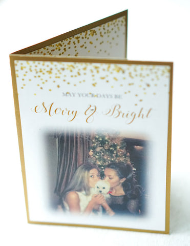 "alt=""This modern photo card features a white matte and antique gold pearlescent shimmer card stock, gold glitter and confetti detail at top with ""May your days be Merry & Bright"" printed below in gold and black writing and a photo of your choice"""