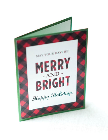 "alt=""This modern rustic style card features a white matte card stock on a green pearlescent shimmer card stock, a buffalo plaid pattern and ""May your days be merry and bright"" printed sentiment with ""Happy Holidays"" or Merry Christmas"" in a script font"""