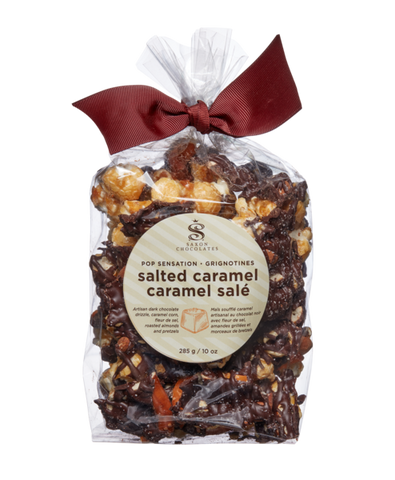 "alt=""An addictive mixture of caramel popcorn, roasted almonds, and pretzel pieces all drizzled with Belgian dark and white chocolate and sprinkled with sea salt"""