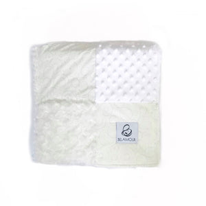 "alt=""White and cream cotton and chenille gender neutral baby blanket with circular pattern"""