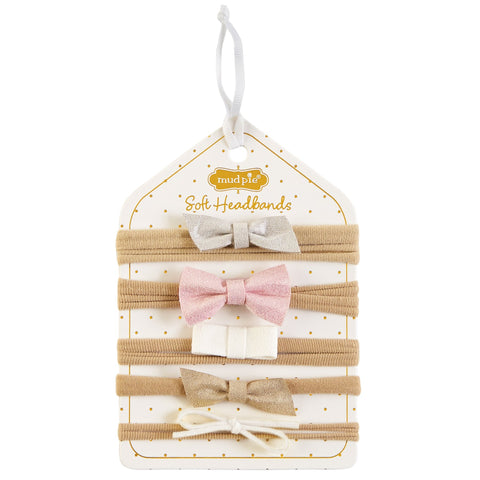 "alt=""Five piece nylon elastic headband set with shimmer faux leather and faux suede pink, white and gold bow toppers on scalloped display card"""