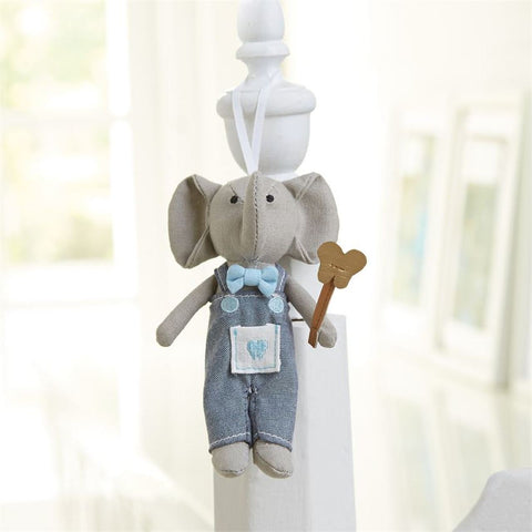 "alt=""Blue and grey Tooth Fairy elephant pocket buddy doll complete with fairy wand, bowtie and chambray bib overalls features a special front pocket to place a lost tooth and hangs from a grosgrain ribbon, comes packaged in corrugated gift box"""
