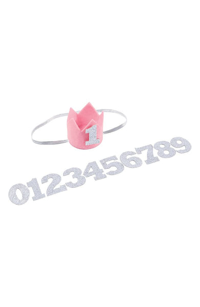 """Monthly milestone headband with pink felt crown headband attaches with an elastic strap and interchangeable silver glitter felt numbers to mark and capture baby's first twelve months"""