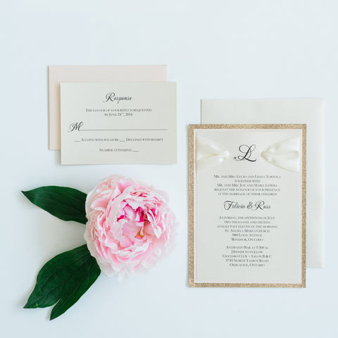 "alt=""Classic rose gold and blush pink wedding invitation with monogram and jewel detail, glitter card stock and ivory satin ribbon"""