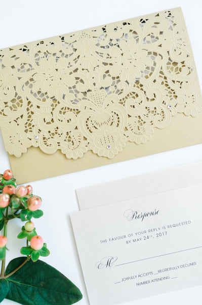"alt=""Graceful gold pearlescent shimmer laser cut  pocket wedding invitation features an ivory pearlescent shimmer stock on a black matte stock insert and is finished with jewel details"""