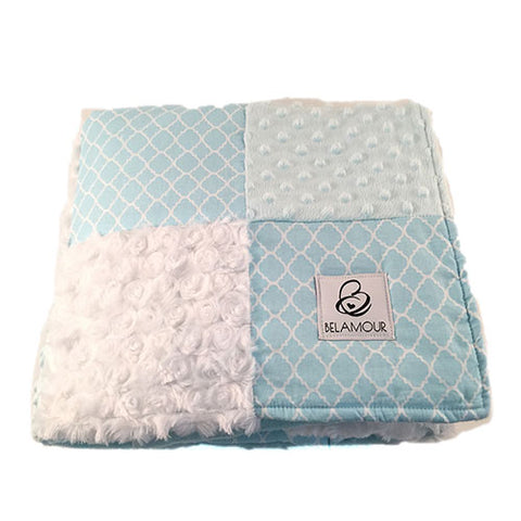 "alt=""Soft blue and crisp white cotton and chenille baby boy blanket with quatrefoil pattern"""