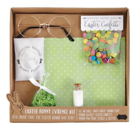 "alt=""Easter Bunny evidence kit includes a paw print stencil kit with cork topped glass vial of glitter, glasses, pastel Easter confetti, Easter Bunny fluff and small bag of Easter paper grass"""